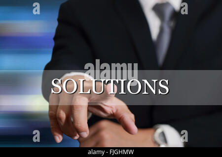 Businessman hand touching Solutions sign on virtual screen as Success concept. - Stock Photo