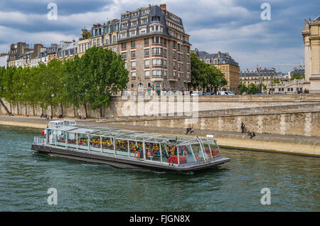 Paris France 2014 April 22,  Tour Boats cruising along the Seine River in Paris - Stock Photo