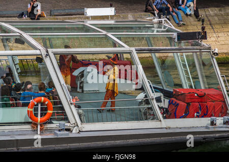 Paris France 2014 April 22,  Tour Boats cruising along the Seine River in Paris - Stock Photo