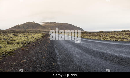 Empty road leading to snow covered mountains, Beautiful landscape in early winter of Iceland - Stock Photo