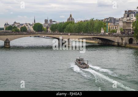 Paris France 2014 April 22,  Police boat patrols along the Seine River in Paris - Stock Photo