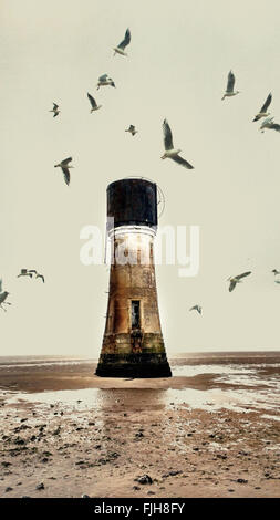 old abandoned lighthouse on the beach and seagulls - Stock Photo