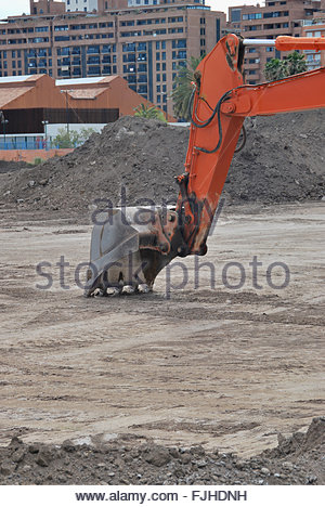 Close-up of excavator's bucket digging - Stock Photo