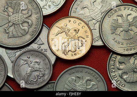 Coins of Russia. Saint George killing the Dragon depicted in the Russian kopek coins. - Stock Photo