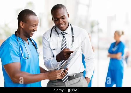 happy African medical doctors looking at the x-ray in office - Stock Photo