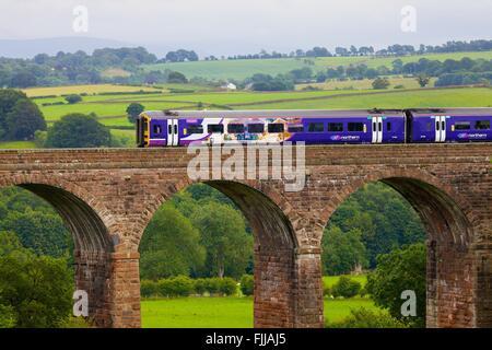 Settle to Carlisle Railway Line. Sprinter passenger diesel train passing over Dry Beck Viaduct, Eden Valley, Cumbria, - Stock Photo