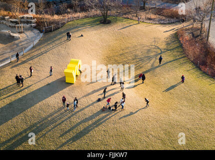 Aerial view of OY/YO sculpture by Deborah Kass on the lawn of Main Street in Dumbo, New York City