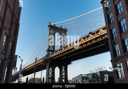 Street view from Dumbo of the Manhattan Bridge linking Manhattan to Brooklyn across the East River. - Stock Photo
