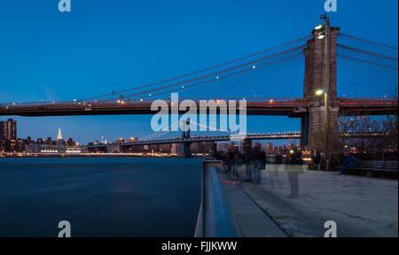 View of Brooklyn Bridge and Manhattan Bridge at twilight along the promenade at Brooklyn Bridge Park / Dumbo. - Stock Photo