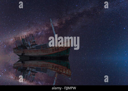The wrecked ship under starry night with clearly  milky way - Stock Photo