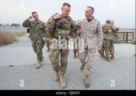 U.S Joint Chiefs Chairman General Joseph Dunford walks along with Army Brig. Gen. Michael Howard at Forward Operating - Stock Photo