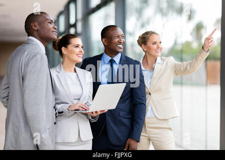 group of successful corporate workers discussing work in modern office - Stock Photo