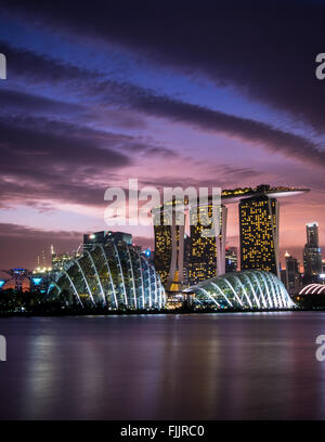Sunset over the skyline in Singapore - Stock Photo