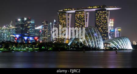 The skyline in Singapore by night - Stock Photo