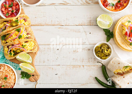Variety of mexican cuisine dishes on a table - Stock Photo