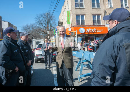 NY Senator Charles Schumer greets police officers Eighth Avenue in the Sunset Park neighborhood in Brooklyn in New - Stock Photo