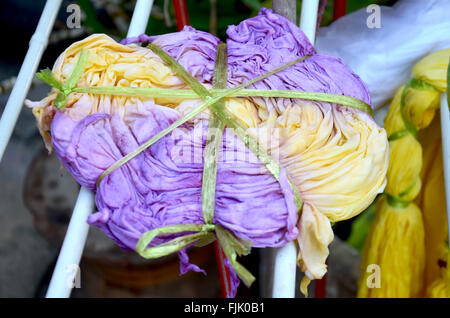 Thai people working process dry clothes in the sun tie batik dyeing yellow natural color made from turmeric plant - Stock Photo