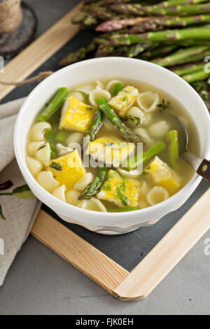 Homemade asparagus and frittata soup - Stock Photo