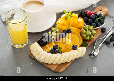 Fruit plate with berries, mango and kiwi - Stock Photo