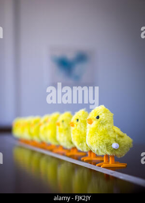 A row of wind-up toy baby chicks. - Stock Photo