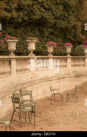 Classical stone urns, balustrades and chairs at Luxembourg Garden, Paris, France - Stock Photo