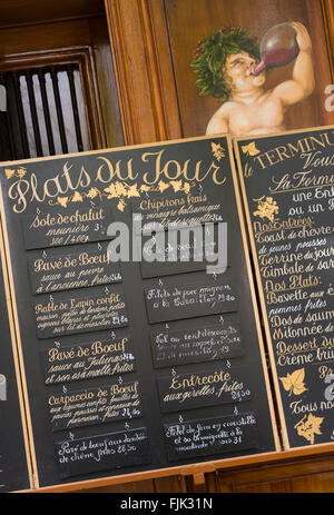 Restaurant menu, Paris France. Dining establishment lists its traditional French 'Plats du Jour', or dishes of the - Stock Photo