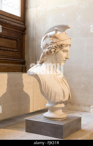Marble bust in classical sculpture gallery at the Louvre Museum, Paris, France - Stock Photo