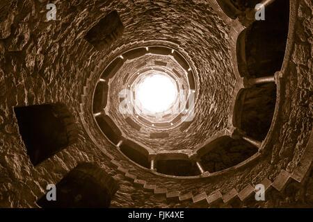 Spiral staircase in stone well at Quinta da Regaliera estate, Sintra, Portugal - Stock Photo