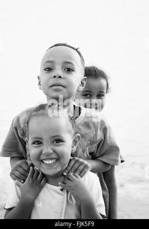 happy smiling ethiopian african kids in harar ethiopia near somalia border - Stock Photo