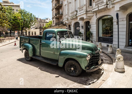 Old American car on street in Montevideo, Uruguay. - Stock Photo