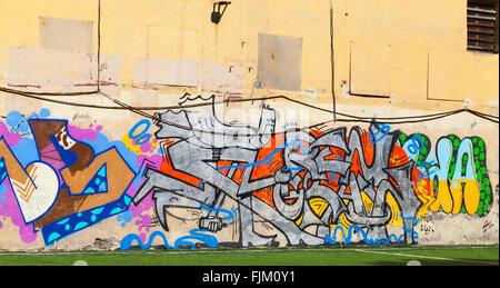 Saint-Petersburg, Russia - May 5, 2015: Urban street art, colorful graffiti patterns. Vasilievsky island - Stock Photo