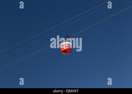 Barcelona cable car cabin port against a clear blue sky - Stock Photo