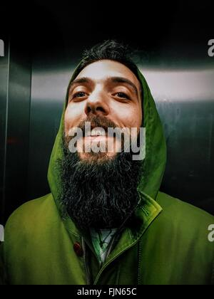Young Cheerful Man With Long Beard In Elevator - Stock Photo