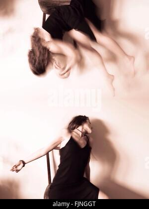 Digital Composite Image Of Young Woman Dancing On Chair - Stock Photo
