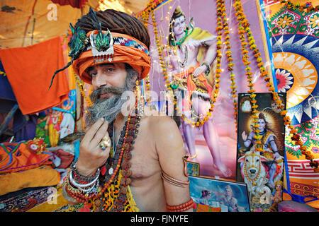 Sadhu (saddhu), a holy man or wandering monk. Sadhus gather at the largest Hindu festival, Kumbh Mela, every 3 years. - Stock Photo