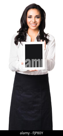 Hispanic waitress in her twenties showing blank digital tablet computer isolated on white background - Stock Photo