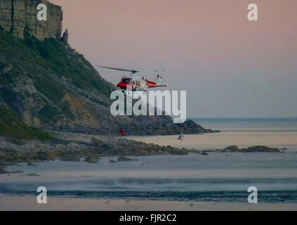 Low Angle View Of Helicopter Flying Over Beach - Stock Photo