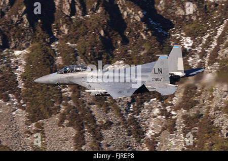 US Air Force F-15E Strike Eagle aircraft, low-flying in Wales, UK. - Stock Photo