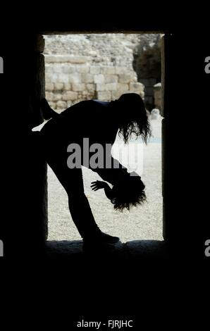 Silhouette Woman Playing With Child At Doorway - Stock Photo