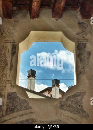 Low Angle View Of Smoke Stacks Seen Through Historic Building - Stock Photo