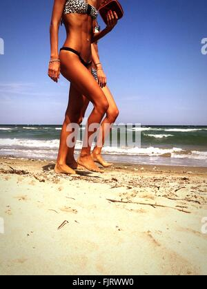 Two Women Walking On Beach - Stock Photo