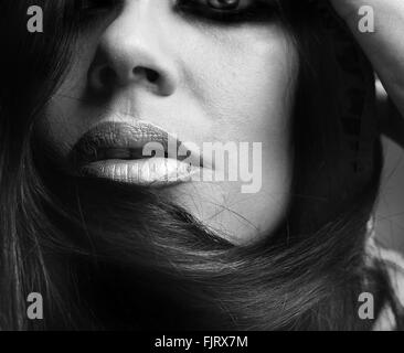 Close-Up Of Beautiful Woman With Long Black Hair - Stock Photo