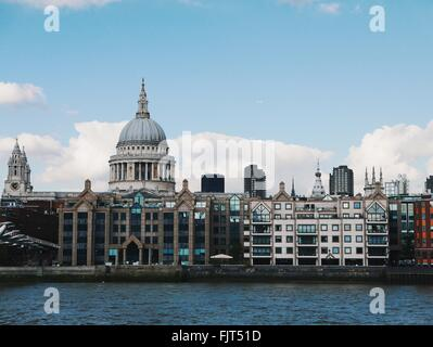 St Paul Cathedral Against Sky Seen From Thames River - Stock Photo