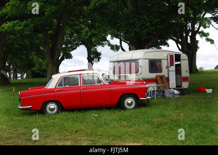 classic camping in 1970s Morris Oxford at Charlbury Cotswolds United Kingdom Stock Photo