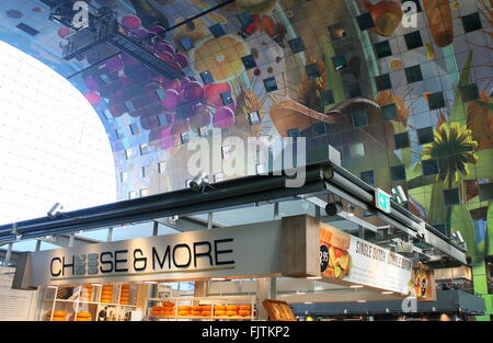 Cheese vendor and colourful artwork on the ceiling of the Rotterdamse Markthal (Rotterdam Market hall), Rotterdam, - Stock Photo