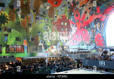 Extremely colourful artwork on the ceiling of the Rotterdamse Markthal (Rotterdam Market hall), Rotterdam, Netherlands - Stock Photo