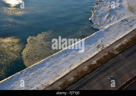 Winter ice on Lake Michigan along Lake Shore Drive in Chicago, Illinois - Stock Photo