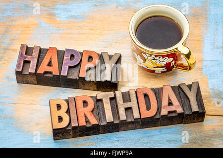 happy birthday card with cup of coffee, chocolates and white heart, Birthday card