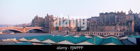 Panoramic view of Edinburgh over Waverley Railway Station along Market Street with North Bridge on left - Stock Photo