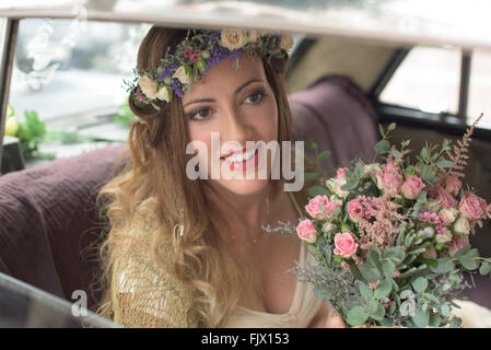 Smiling Bride With Flower Bouquet Sitting In Car - Stock Photo